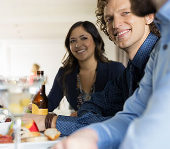 The Vue32 apartment complex features a club lounge with spectacular Philadelphia city views, an open kitchen and comfortable seating.